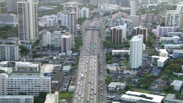 ws aerial traffic moving on highway in honolulu / hawaii, united states - honolulu stock videos and b-roll footage