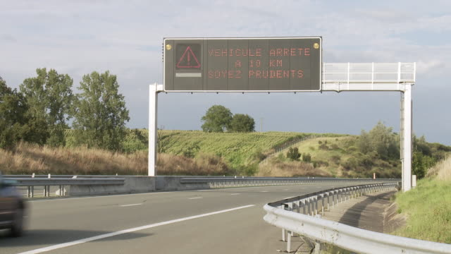 ms traffic moving on highway in rural area / lit-et-mixe, aquitaine,  france - aquitaine stock videos and b-roll footage