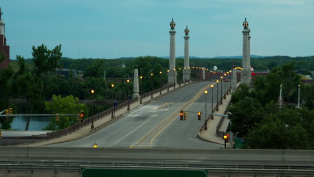 ws t/l  traffic moving on memorial bridge day to night / springfield, massachusetts, united states    - springfield massachusetts stock videos & royalty-free footage