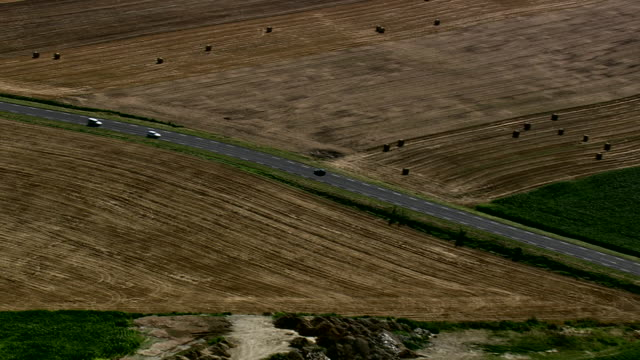 vidéos et rushes de ws aerial zi zo pan ts traffic moving on motorway through farm field / picardy, france - route de campagne