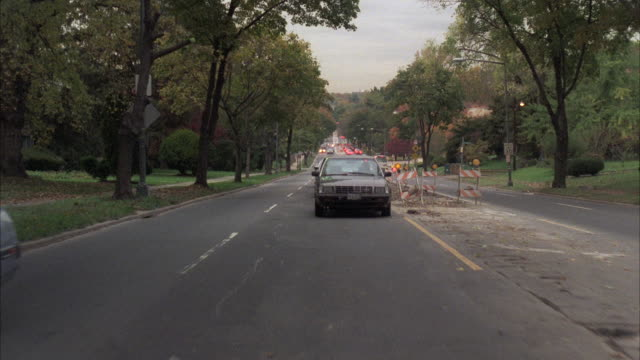 ms pov traffic moving on road in city / washington dc, united states - treelined stock videos & royalty-free footage