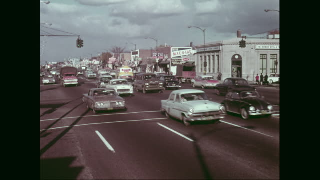 ws traffic moving on road in detroit, michigan, united states - 1960 stock videos & royalty-free footage