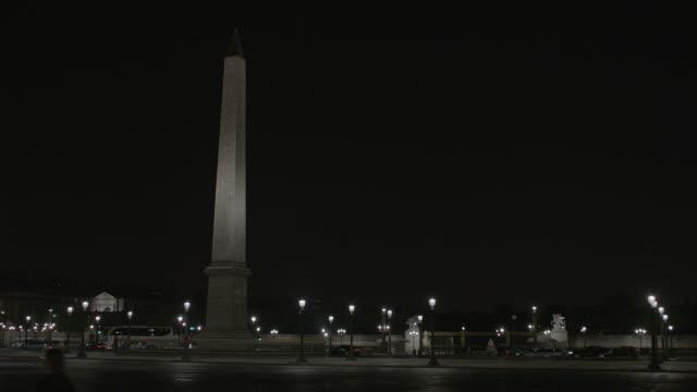 WS Traffic moving on street near Luxor Obelisk at night / Paris, France