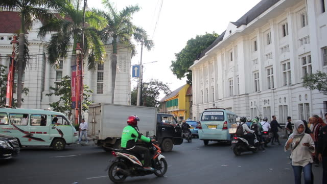 traffic near old town in jakarta - indonesia street stock videos & royalty-free footage