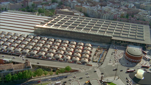 aerial traffic next to atocha train station, madrid, spain - railroad station stock videos & royalty-free footage