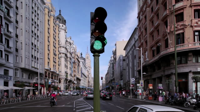 WS Traffic obeying an ever changing traffic signal on Grand Via / Madrid, Spain