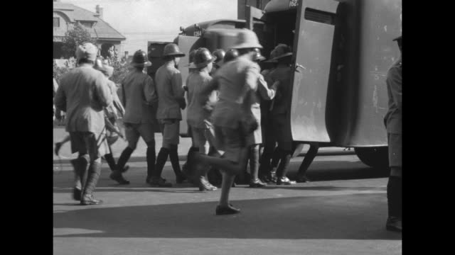 traffic of carts and rickshaws on a city street in the shanghai international settlement / men of a riot squad line up as an armored truck drives... - armored truck stock videos and b-roll footage
