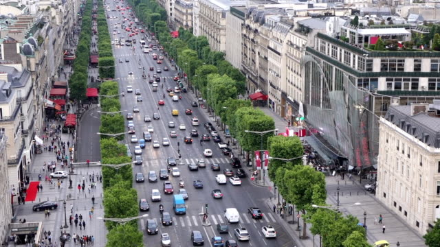 traffic of champ elysees street from arc triomphe - avenue des champs elysees stock videos & royalty-free footage
