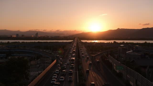 traffic of deokcheon ic at sunset / buk-gu, busan, south korea - symmetry stock videos & royalty-free footage