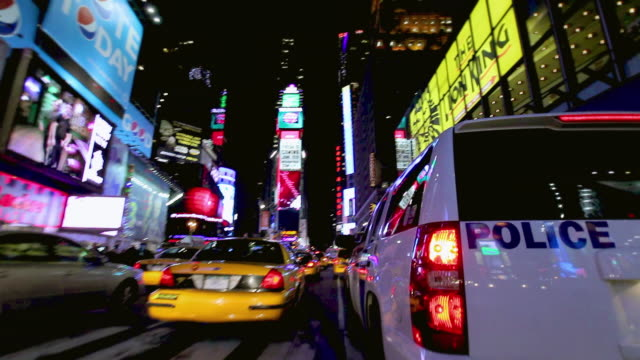 ws pov traffic of times square at night, huge advertisements and broadway show signs by street side / new york city, new york, usa - broadway manhattan stock videos & royalty-free footage