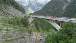 AERIAL Traffic on a bridge above a canyon high in the mountains