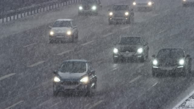 ld traffic on a highway in a snow storm - blizzard stock videos & royalty-free footage
