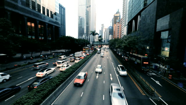 traffic on a rainy day along gloucester road on hong kong - hong kong island stock videos & royalty-free footage