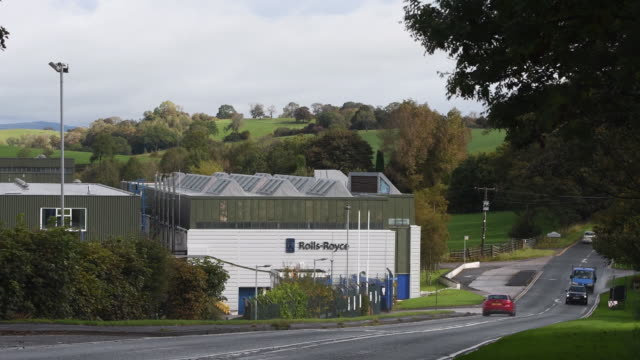 traffic on a road outside the rolls royce plant in barnoldswick, lancashire, uk on tuesday, october 6, 2020. - automobile industry stock videos & royalty-free footage