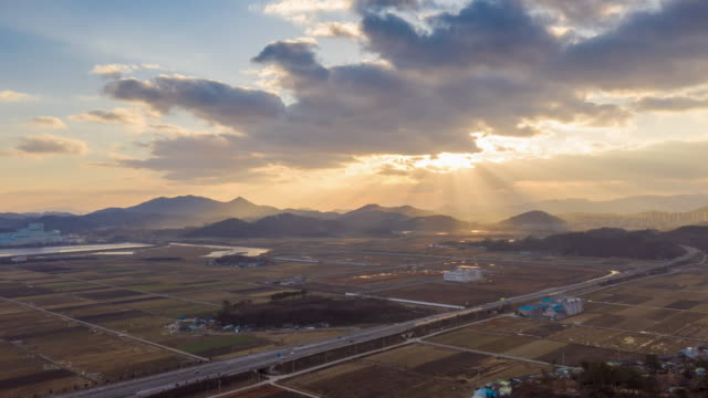 traffic on a road with shafts of sunlight / mokpo-si, jeollanam-do, south korea - clear sky stock videos & royalty-free footage