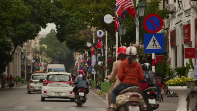 traffic on a street in hanoi during the day during the trump kim summit - symbol stock-videos und b-roll-filmmaterial