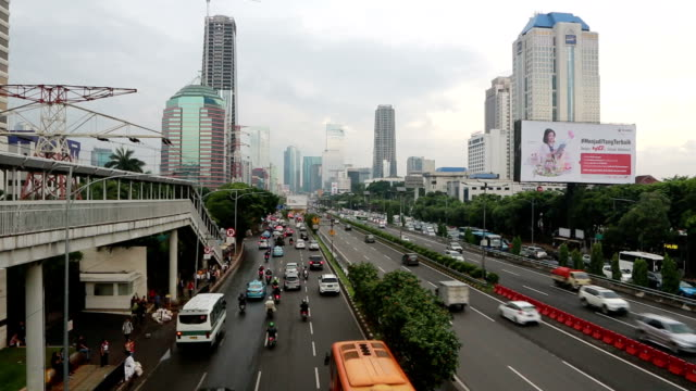 Traffic on a very busy avenue in Jakarta, Indonesia capital city