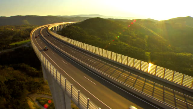 Traffic On A Viaduct At Sunset