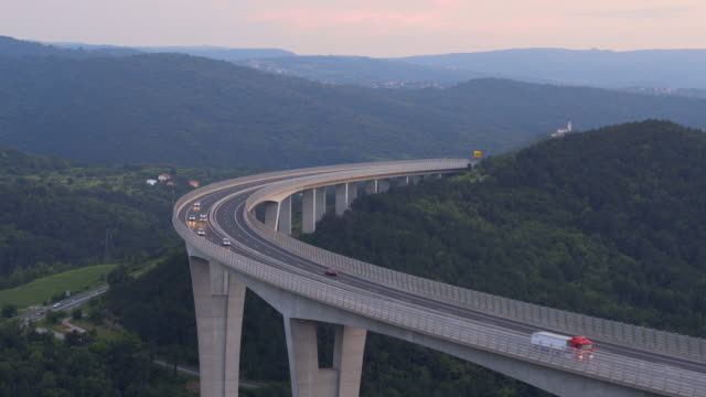 traffic on a viaduct at sunset - viaduct stock videos & royalty-free footage
