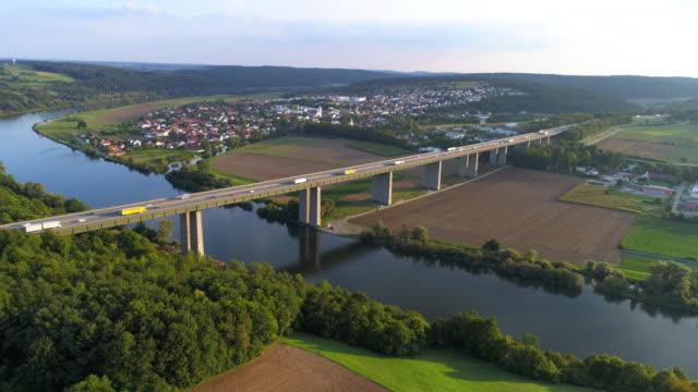 traffic on autobahn bridge over the danube river near regensburg - regensburg stock videos & royalty-free footage