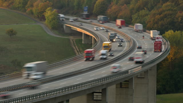 t/l traffic on autobahn bridge (dawn) - heavy goods vehicle stock videos & royalty-free footage