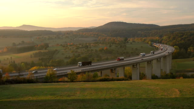 traffic on autobahn bridge (dawn) - lastzug stock-videos und b-roll-filmmaterial