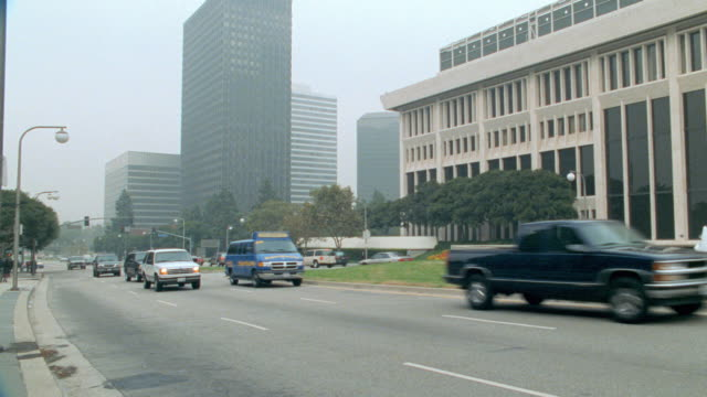 traffic on avenue of the stars passes by the century plaza towers in los angeles. - century city stock videos & royalty-free footage