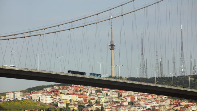 t/l ms la traffic on bosphorus bridge with communication towers in background, istanbul, turkey - july 15 martyrs' bridge stock videos & royalty-free footage