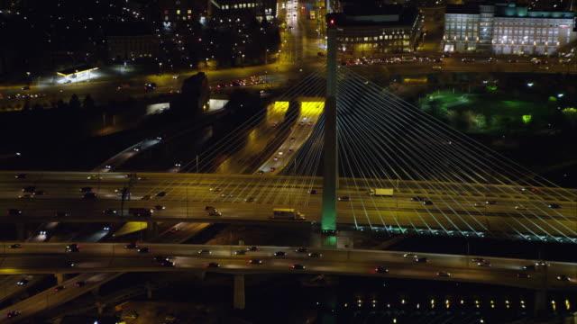 traffic on boston's leonard p. zakim bunker hill memorial bridge at night. shot in november 2011. - boston massachusetts stock videos & royalty-free footage