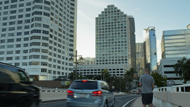 traffic on brickell key drive - miami dade county stock videos & royalty-free footage