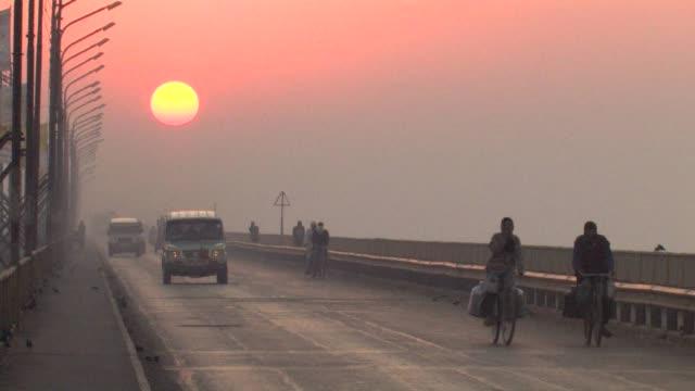 MS, Traffic on bridge at sunrise, Allahabad, Uttar Pradesh, India