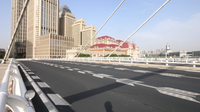 traffic on bridge in modern city - tianjin stock videos and b-roll footage