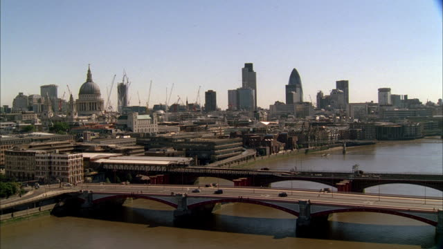 aerial traffic on bridges over the river thames, skyline beyond including the dome of st. paul's cathedral / london, england, united kingdom - st. paul's cathedral london stock videos and b-roll footage