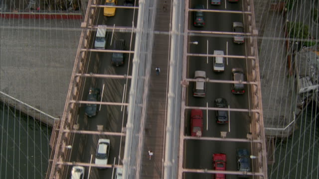AERIAL Traffic on Brooklyn bridge and cityscape / New York City, New York, USA
