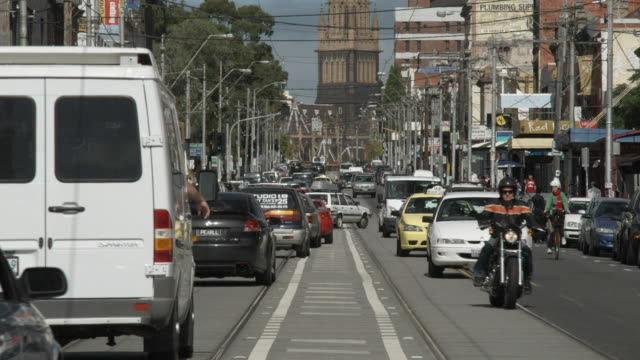 MS TU Traffic on Brunswick Street, St. Paul's Cathedral tower in background, Melbourne, Victoria, Australia