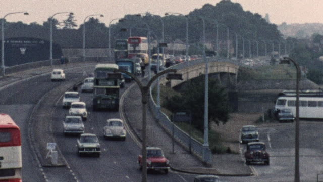 1974 MONTAGE Traffic on busy roads / Southampton, Hampshire, England