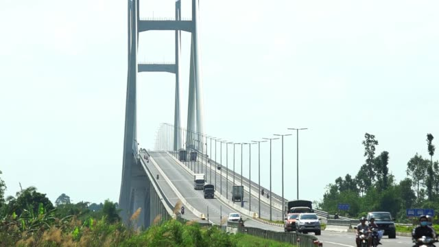 traffic on cao lanh bridge cable stayed on the mekong river - suspension bridge stock videos & royalty-free footage