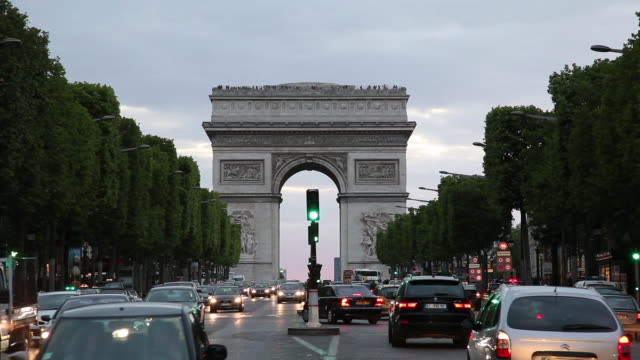 WS Traffic on Champs Elysees with Arc De Triomphe in background, dusk/ Paris, France
