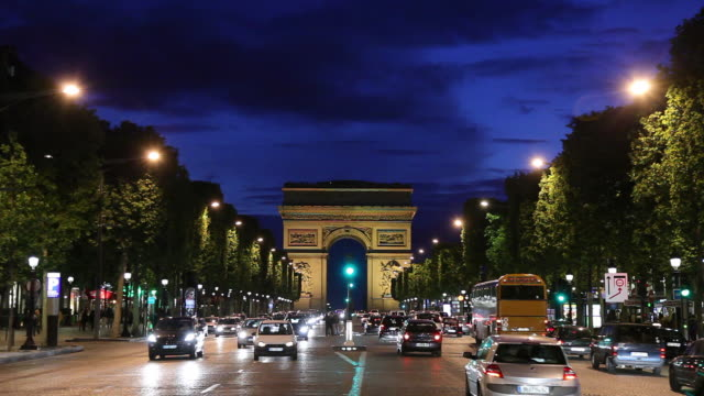 WS Traffic on Champs-Elysees at night, Arc De Triomphe in background / Paris, France