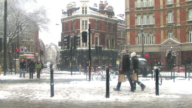 ws traffic on charing cross road covered with snow, london, united kingdom - charing cross stock videos and b-roll footage