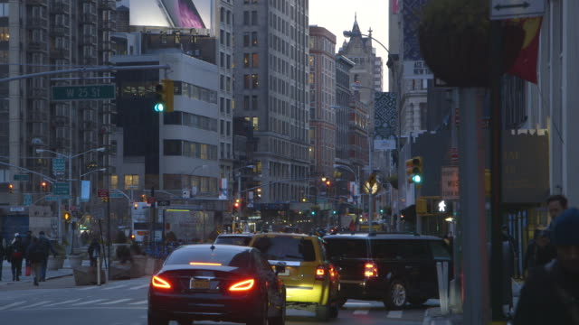 traffic on chelsea street in manhattan, wide shot - chelsea new york stock videos & royalty-free footage