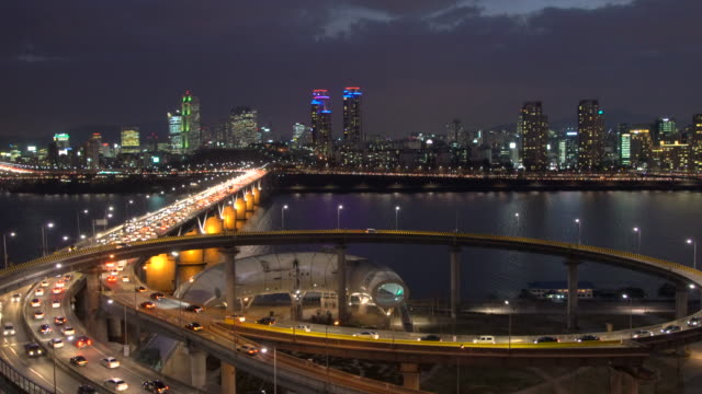 Traffic on Cheongdam on-ramp and Cheongdam Bridge over Hangang River, Seoul, South Korea