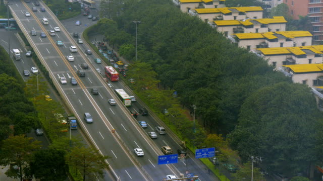 traffic on city highway in guangzhou. view from above - spoonfilm stock-videos und b-roll-filmmaterial