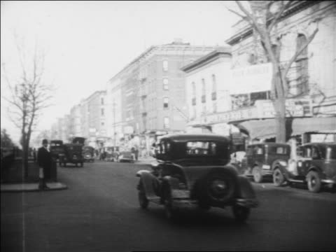 b/w 1930 traffic on city street in harlem / new york city / newsreel - 1930 stock videos & royalty-free footage