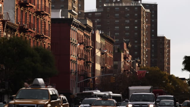 ws tu traffic on city street with apartment buildings in background / new york city, new york state, usa - brick stock videos & royalty-free footage