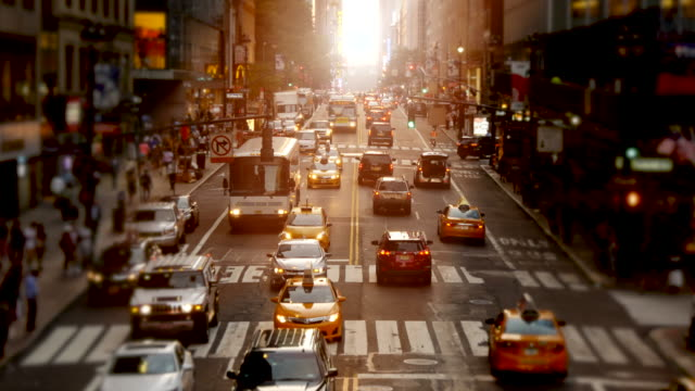 Traffic on City Streets in a Metropolis. Cars and other Vehicles on Crossroads in Large City.