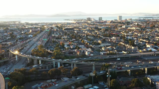 traffic on city's freeways, wide aerial - oakland california stock videos & royalty-free footage