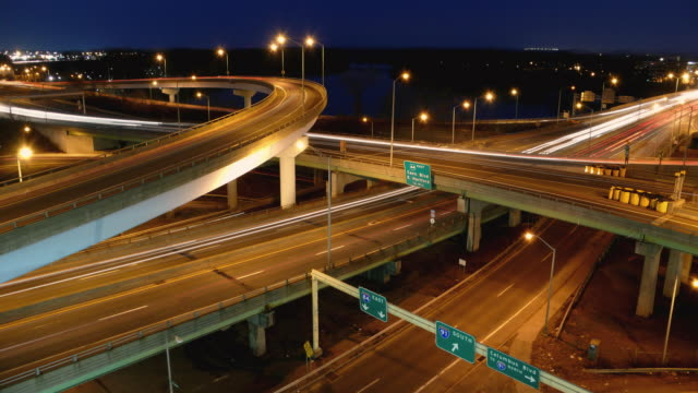 t/l, ws, ha, traffic on clover leaf-shaped highway overpasses, dusk to night, hartford, connecticut, usa - clover leaf shape stock videos and b-roll footage