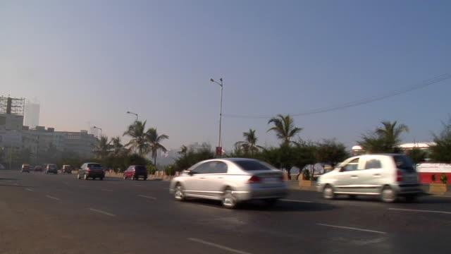 ws, traffic on coastal road, mumbai, maharashtra, india - fan palm tree stock videos & royalty-free footage