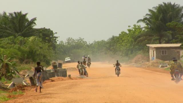 ws, traffic on dirt road, bonou, porto-novo, benin - benin stock videos and b-roll footage